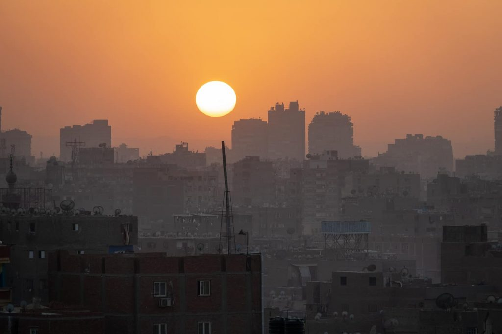 Essential Egyptian Arabic phrases to sound local - sunset over Cairo