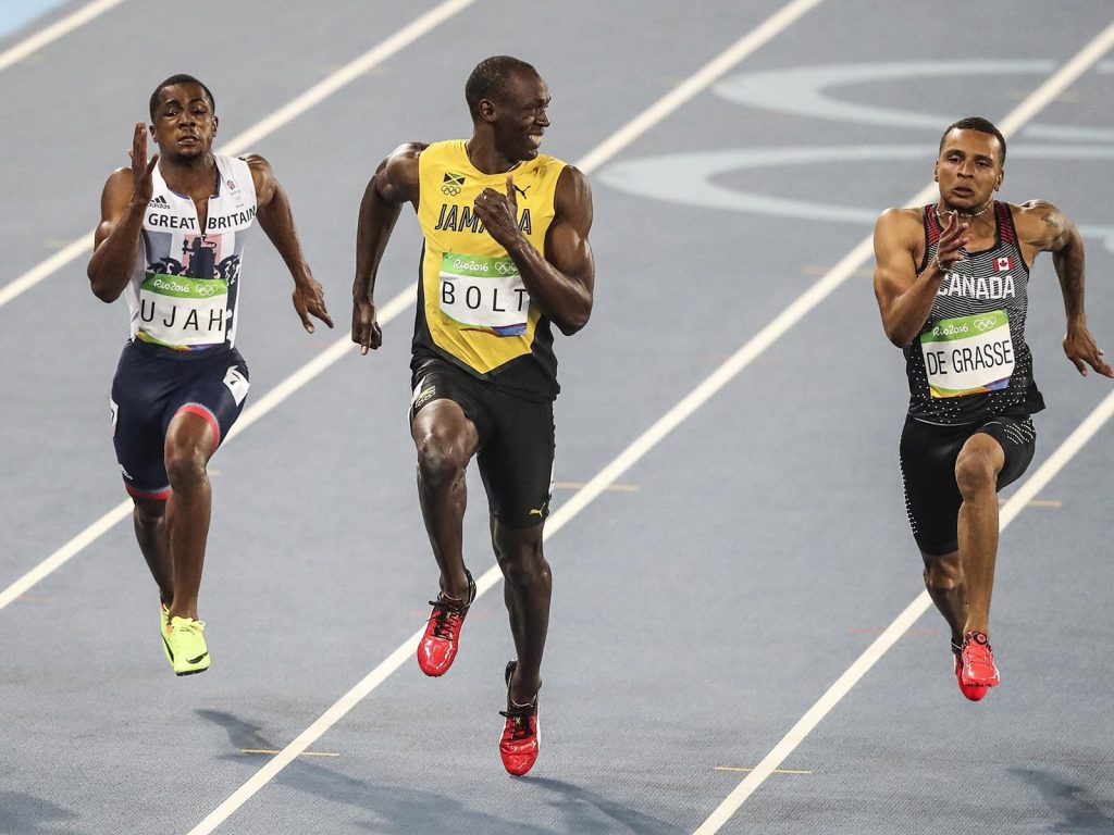 Husain Bolt smiling as he wins a world record. How fast should we be able to run the 100m sprint?