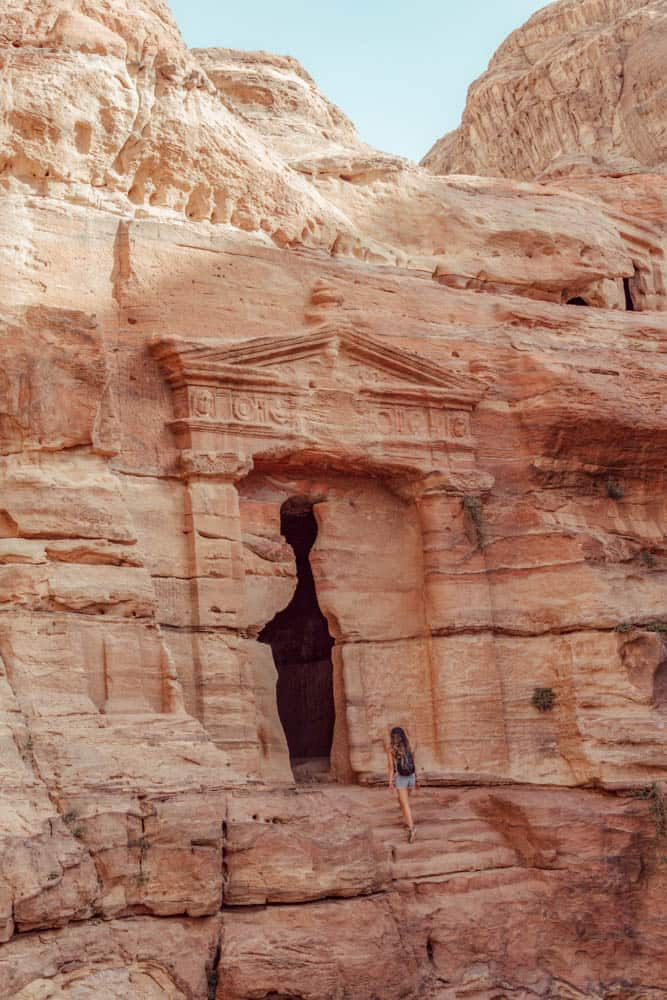Entering Lion Triclinium Tomb in Petra - hiking trails in Petra