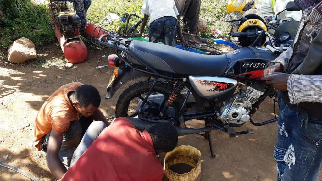 My motorcycle being repaired, thwarting day 10 of running in Iten