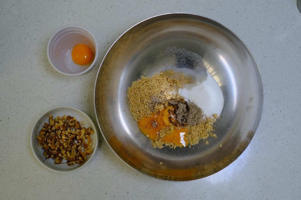 Ingredients for Persian walnut cookies in a bowl